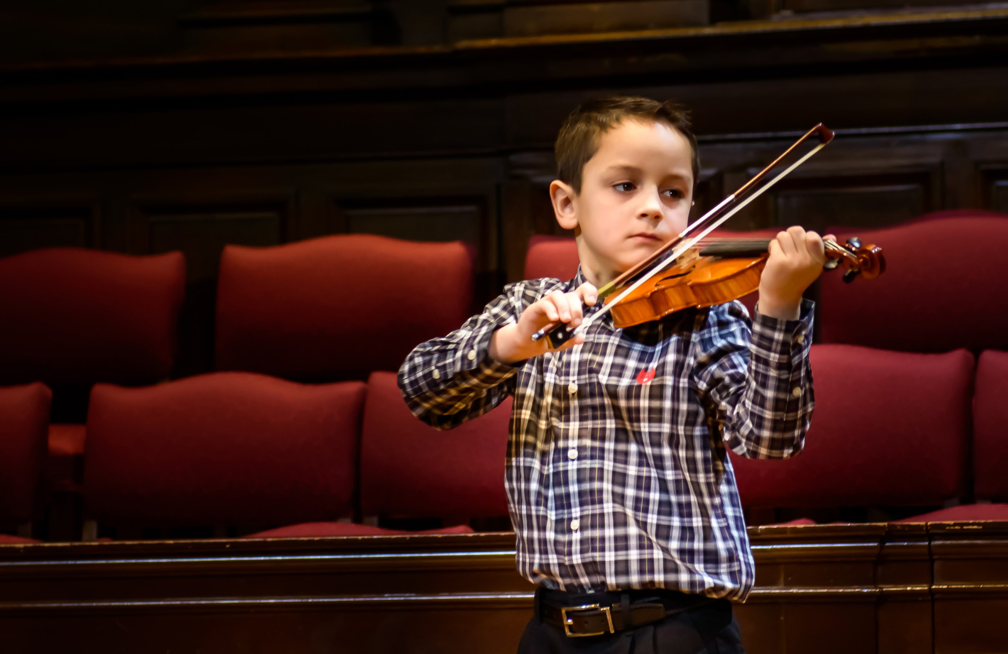 Image of young Academy of Strings student playing violin in individual Music Lesson