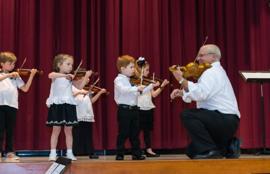 Image of young Academy of Strings students playing violin