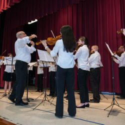 Image of Academy of Strings students playing violin for concert
