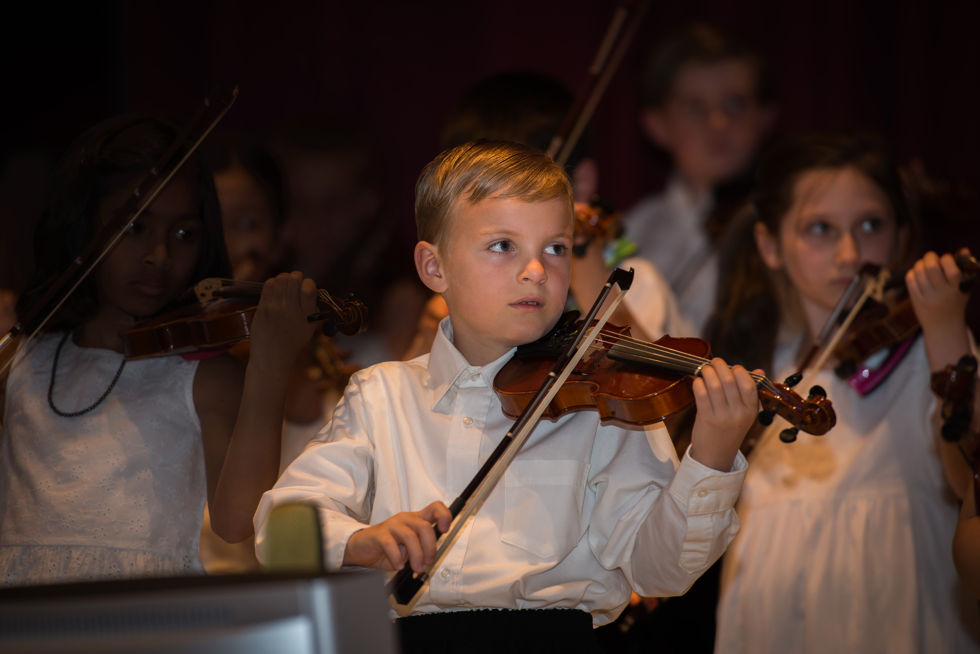 Image of young Academy of Strings students performing violin